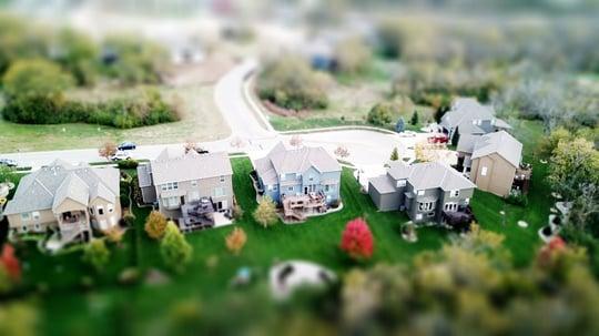 A bird's-eye-view of a cul-de-sac of homes